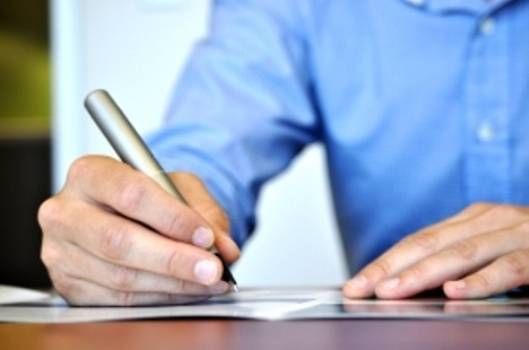 Employee writing on a paper
