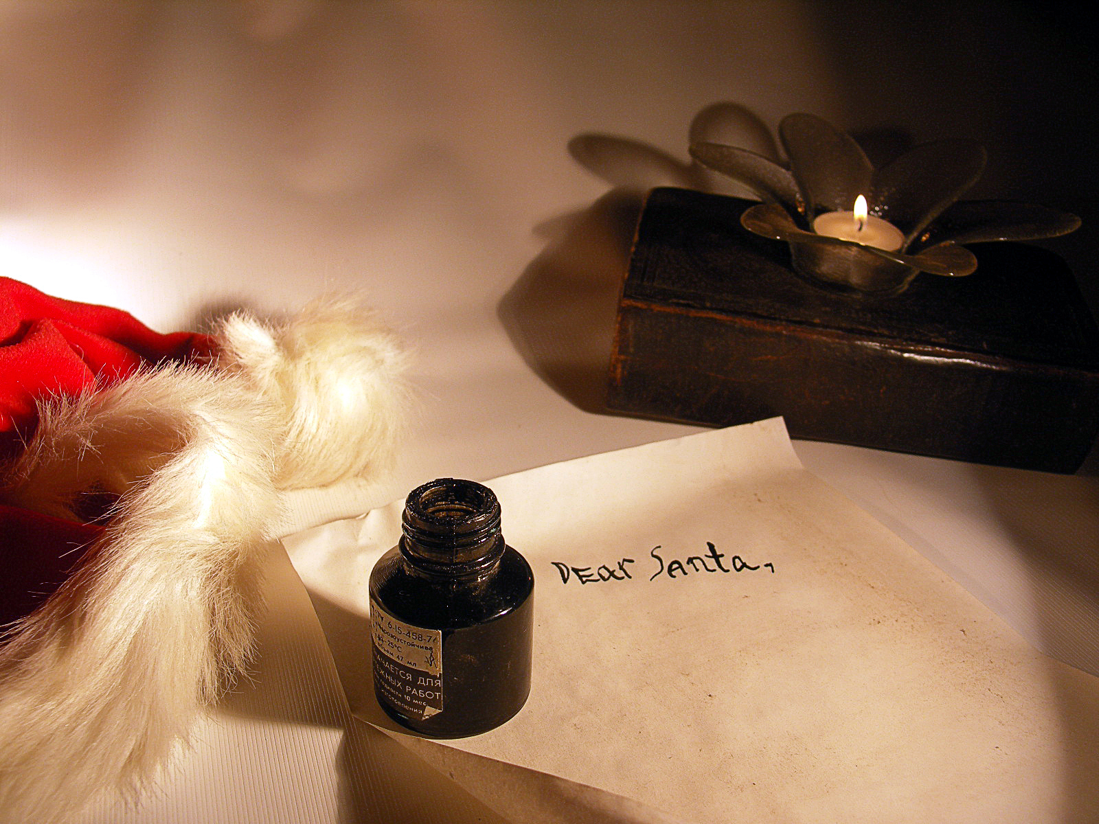 Letter with an ink pot on top for writing to Santa